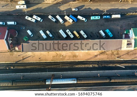 Aerial view of many cars and buses moving on a busy city street. #1694075746