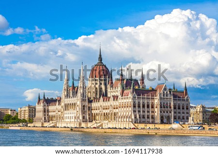 Building of the Hungarian National Parliament in Budapest, Hungary. Notable landmark of Hungary, and a popular tourist destination in Budapest. Designed in neo-Gothic style Royalty-Free Stock Photo #1694117938