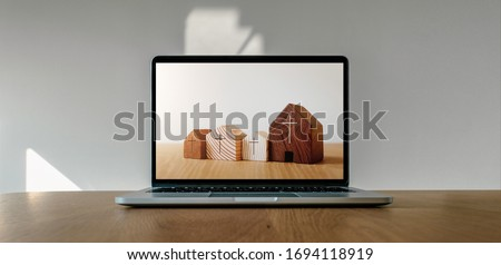 Worship from home, Online live church for sunday service, Laptop screen with wooden cross church photo on wooden table Royalty-Free Stock Photo #1694118919