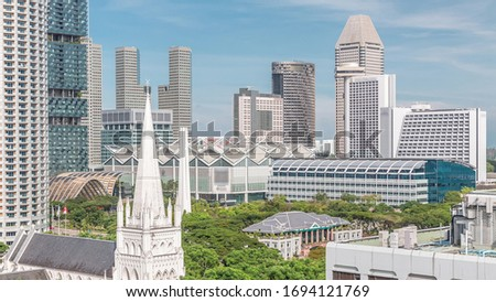 St. Andrew's Cathedral aerial view. It is an Anglican cathedral in Singapore, the country's largest cathedral. Skyscrapers on a background