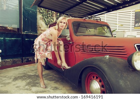 Fashion style in dress with old school car in vintage #169416191