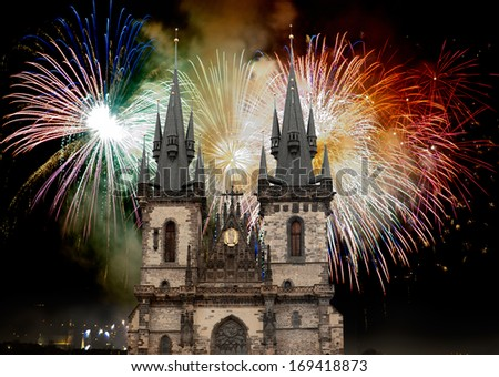 Tyn Church in Prague on the background of the New Year fireworks