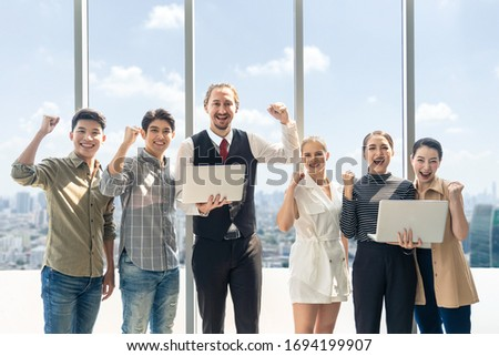 Group of business teamwork people have successful business talk meeting stand in high rise skyscraper building. People cheer up each other of conclusion planning. Cityscape office view in background. #1694199907