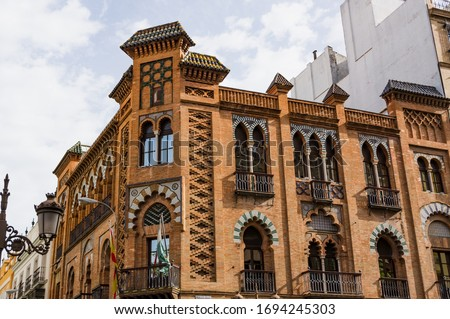 Historic buildings and monuments of Seville, Spain. Architectural details, stone facade and museums Europe. Spanish architectural styles of Gothic and Mudejar, Baroque #1694245303