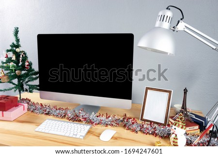 mock up set up of computer desktop system laying on wooden desk with monitor wireless keyboard and mouse, home computer in living room working at home concept, using smart technology, grey background #1694247601