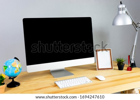 mock up set up of computer desktop system laying on wooden desk with monitor wireless keyboard and mouse, home computer in living room working at home concept, using smart technology, grey background #1694247610