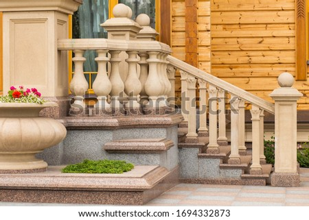 White stone balusters. Baroque balustrade. Outdoor sandstone stairs and balustrades. The detail with depth of field of balustrade with beige sandstone. sandstone architecture. sandstone railing.granit Royalty-Free Stock Photo #1694332873
