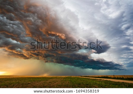 Stormy sky with dramatic clouds from an approaching thunderstorm at sunset