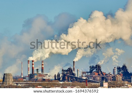 Poor environment in the city. Environmental disaster. Harmful emissions into the environment. Smoke and smog. Pollution of atmosphere by plant factory. Exhaust gases. #1694376592