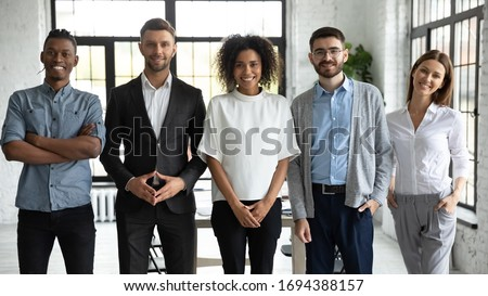 Portrait of standing in row smiling diverse team posing differently looking at camera. Happy young multiethnic corporate staff, bank workers photo shoot, HR agency recruitments. #1694388157