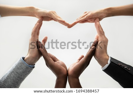 Close up bottom view concept of diverse business people join hands forming heart. Show unity and support, protection of business. Multiracial colleagues involved in team building activity for charity. #1694388457