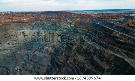 Aerial view of the Iron ore mining, Panorama of an open-cast mine extracting iron ore, preparing for blasting in a quarry mining iron ore, Explosive works on open pit #1694399674