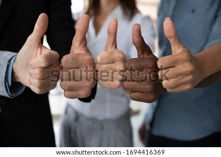 Close up view of diverse business team people hands showing thumbs up like finger gesture recommendation or good job choice. Professional multicultural team recommend corporate service. #1694416369