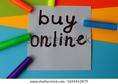"Sticker with the inscription ""BUY ONLINE"" on a bright and colorful background #1694452879"