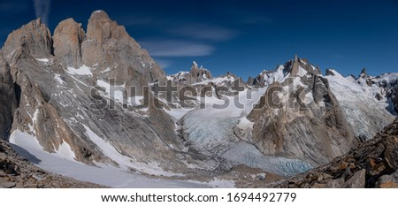 Panoramic view from Cuadrado passlocated near river Electrico, Argentina. From left to right - mountsGuillaumet, Mermoz,Fitz Roy with its northern glacier, mount Torre and mount Aguja Pollone. #1694492779