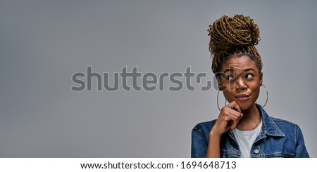 Lady thinking looking away holding her hand to her face and hugs herself Royalty-Free Stock Photo #1694648713