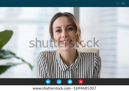 Pc screen view, head shot portrait businesswoman makes videocall looks at webcam consult client distantly, confident business lady lead job interview communicates with applicant by video telephony app #1694685307