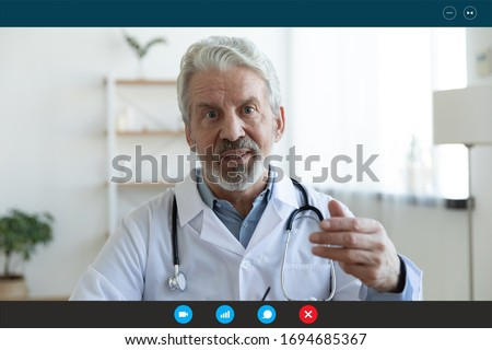 Ask general practitioner online, video call consultation, patient and doctor talk concept. Head shot of mature male therapist share information provide support, laptop screen view, videoconference app Royalty-Free Stock Photo #1694685367