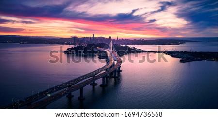 Aerial view of San Francisco Oakland Bay Bridge and Treasure Island at Sunset, California, USA