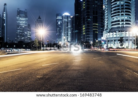 The light trails on the modern building background in shanghai china #169483748