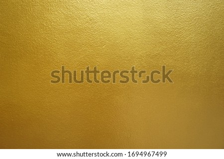 Gold foil texture background sparkly filled with shiny gold glitter in Thailand. #1694967499