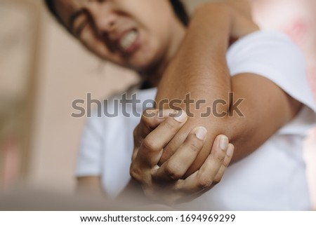 Young woman pain in elbow, health care concept. #1694969299