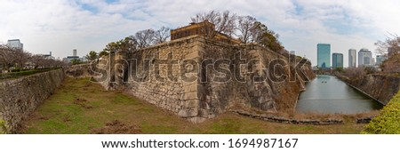 A panorama picture of Osaka Castle Park, showing the main moat and the walls around the castle.