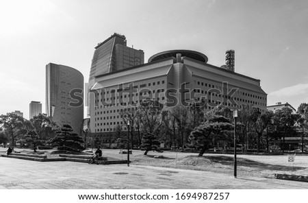 A black and white picture of the Osaka Museum of History and the Osakafu Police Headquarters' buildings.