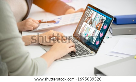 Businesswoman watching laptop webinar video course at home office.Happy woman student listening lecture study online protection covid-19.Webinar E-business,e learning and seminar online Concept. #1695039520