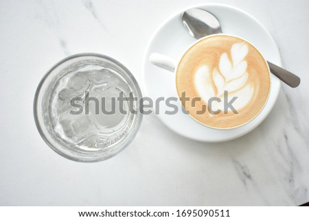 A glass of beautiful latte and water #1695090511