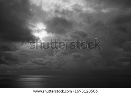 Beautiful blue sunset on the ocean with big waves and cliffs and cliffs. Bali island with its tropical and exotic nature. Sunrise over the sea and ocean. Phantom blue in sunset #1695128506