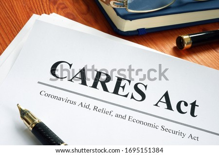 Coronavirus Aid, Relief, and Economic Security CARES Act on the desk. #1695151384