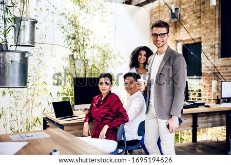 Best team. Cheerful men and women looking at camera and smiling stock photo