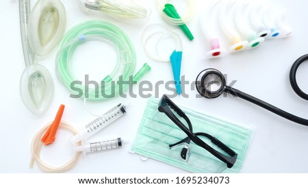 Medical equipment for airway management : stethoscope, oral airway, goggles, surgical mask and endotracheal tube on white background                                         Royalty-Free Stock Photo #1695234073