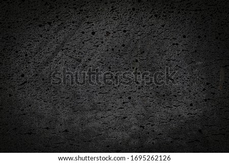 coarse black texture and background of basalt material Royalty-Free Stock Photo #1695262126