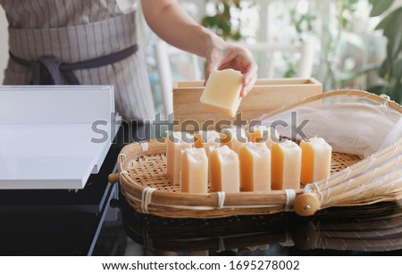 Process handmade soap. Woman cutting handmade soap. Prepare handmade soap for cure soap. Close up. Shampoo bar. Royalty-Free Stock Photo #1695278002
