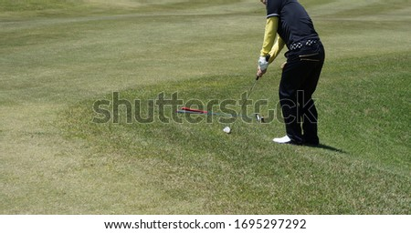 It is a picture of a golf swing at a golf course.