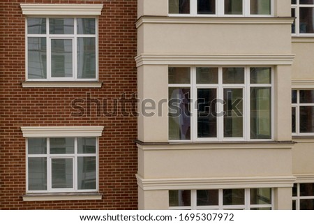 The property. New modern building with balconies, close-up, fragment. Close-up of glass balconies of modern hotel building. #1695307972