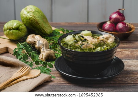 Tinola (Zoom Out)- a famous Filipino vegetable soup dish that is usually made from ginger, fish sauce and chicken broth, usually mixed with  moringa (malunggay) and chayote