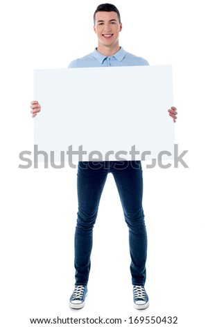 Young man holding blank white board #169550432