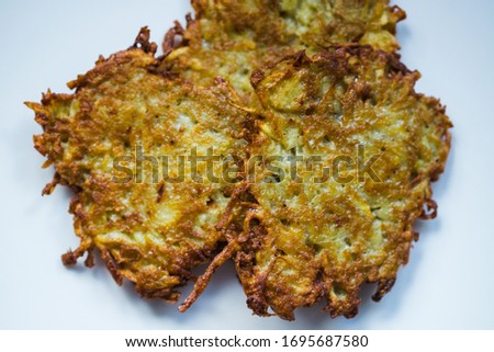 Picture of potato pancakes on a white plate, top view