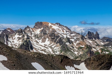View of Mont Thabor (3178m) and in the distance The White Horse (Le Cheval Blanc- 3020m) located in Massif de Cerces in Hautes Alpes,France.Here it is seen from the mountain pass du Lac Blanc (2935m) #1695711964