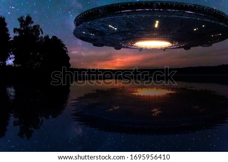 UFO, an alien plate hovering above water, hovering motionless in the air. Unidentified flying object, alien invasion, extraterrestrial life, space travel, humanoid spaceship mixed medium Royalty-Free Stock Photo #1695956410