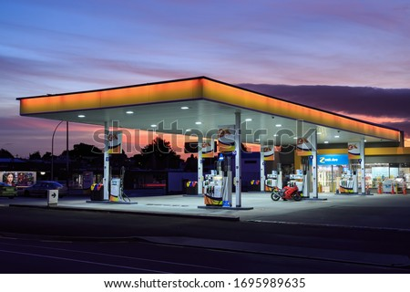 "Tauranga / New Zealand - 24 March 2020: A ""Z"" (Formerly Shell) Gas Station, Lit Up at Sunset #1695989635"