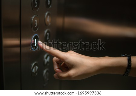 The finger is the push button of the elevator. Royalty-Free Stock Photo #1695997336