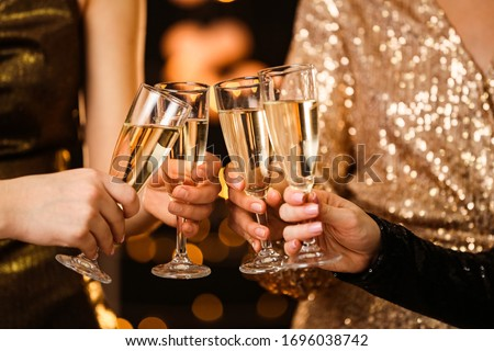 Women clinking glasses of tasty champagne at party Royalty-Free Stock Photo #1696038742