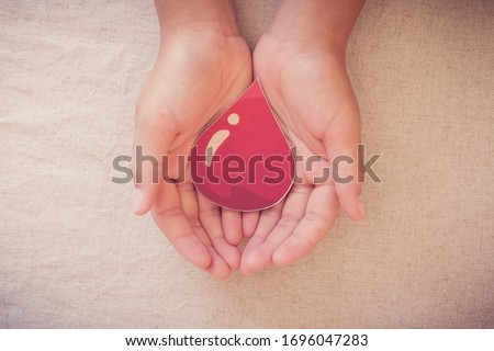 Hands holding blood drop,  give blood donation, blood transfusion, world blood donor day, world hemophilia day concept #1696047283