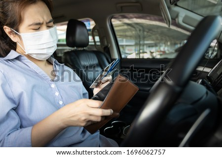 Business woman holding empty money in wallet,no cash for expenses home,credit card debt,debt of car,bankrupt girl with financial problem,economic depression during the Coronavirus,Covid-19 pandemic #1696062757