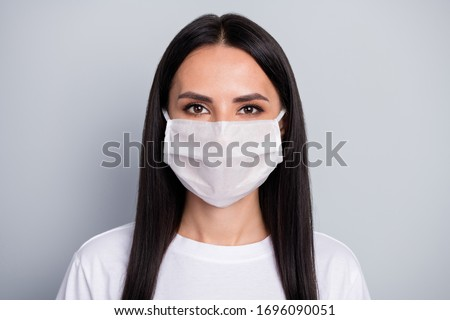 Portrait of serious girl corona virus infection patient want stop bio danger bacteria spreading wear medical mask clothes isolated gray color background #1696090051