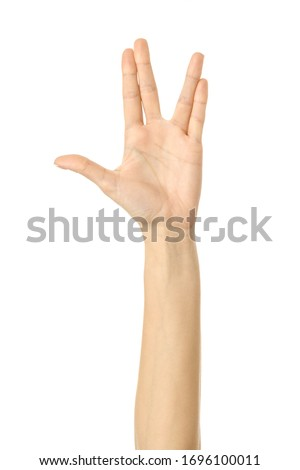 Vulcan salute. Woman hand with french manicure gesturing isolated on white background. Part of series